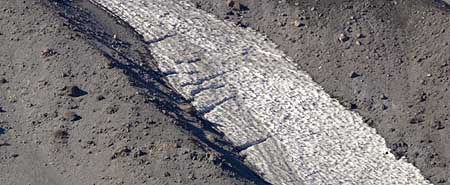 A close-up view of the mini-glaciers reveals classic crevasses