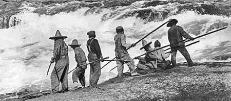 Indians fishing Celilo Falls with dip nets in the early 1900s, prior to construction of dams at Bonneville and The Dalles.