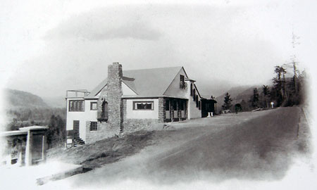The Falls Villa roadhouse was located across the road from today's wayside through the 1930s, now marked only by a stand of mature bigleaf maple