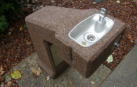 Accessible drinking fountain located outside the restroom
