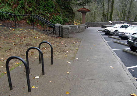 Centrally located bike racks front the main parking area