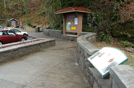 The view toward the visitor signboard and steps leading to the upper falls viewpoint from the new plaza (interpretive sign in foreground)