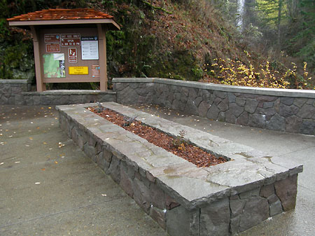 A large planter bench anchors the new plaza