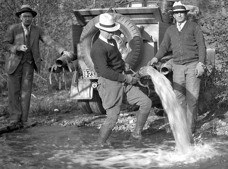 Alva Day (left) overseeing the release of hatchery fry in 1933 (source: Hood River History)