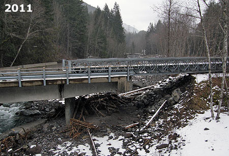 The Old Maid Flat Bridge over the Sandy River was repaired with a temporary approach ramp (on the right in this photo) where the bridge approach had washed out by raging water
