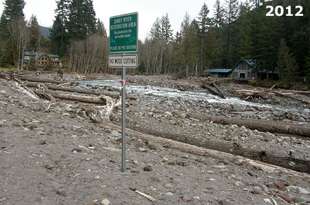 The two homes in the distance barely survived the 2011 flood event on the Sandy River