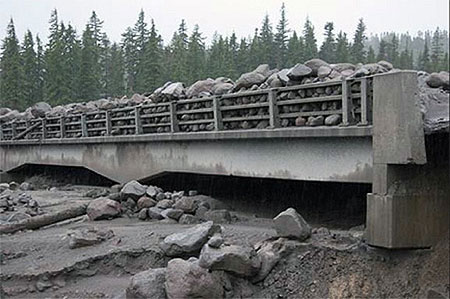 During the 2006 debris flows, the old White River Bridge was completely inundated, leaving an eight-foot layer of boulders on the bridge (ODOT)