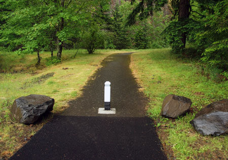 New bollard and boulders, but no sign to mark the Mitchell Point trail?