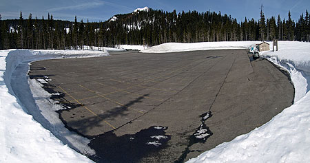 Meadows parking lots are mostly empty outside of a few weekend peaks from December through February. This photo was taken on a sunny Saturday in March, 2009 at the huge Hood River Meadows lot. The tiny structure on the right is the Nordic Ski Center, for scale. Only about a third of the sprawling lot can be seen in this photo