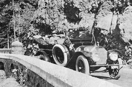 Close-up view of the vehicle carrying Sam Lancaster as he passed Shepperd's Dell during the grand opening of the Columbia River Highway in June 1916.