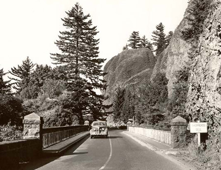 The bridge at Shepperd's Dell in the 1940s, complete with a white highway sign from that era.