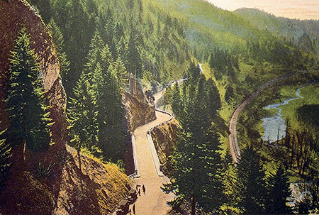 This unusual hand-colored photo from the 1920s is from the Bishops Cap, looking west toward the bridge at Shepperd's Dell. Though the trees have grown, much of the rest of this scene is preserved today.