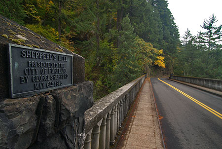 Shepperd's Dell bridge and the modest memorial plaque