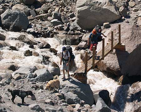Hikers on the seasonal bridge over the Eliot Branch that was in place from the mid-1990s until 2006