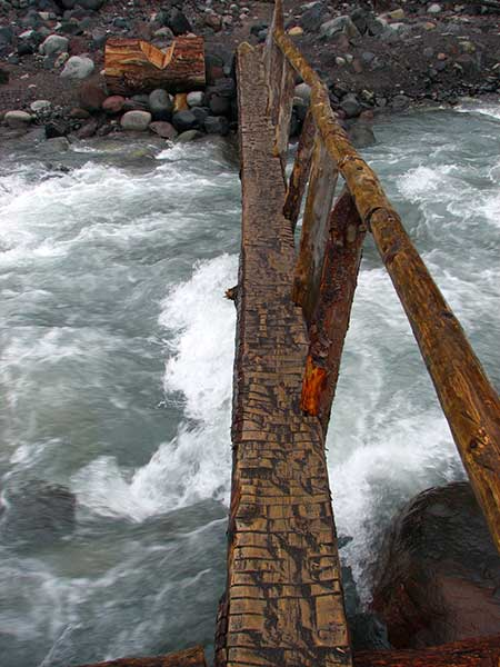 The National Park Service continually maintains dozens of wilderness bridges on the 92-mile long Wonderland Trail around Mount Rainier, despite much worse washouts and much more difficult crossings than anything found on Mount Hood (Wikimedia)