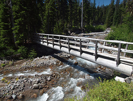 Sadly, this fine bridge over Clark Creek is among the few surviving on Mount Hood, and the only surviving permanent crossing on a glacial stream.