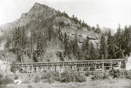 Columbia River Highway bridge at McCord Creek under construction in 1915 (Wauneka Point towers above)