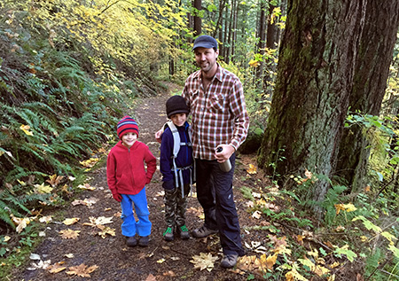 A young family enjoying the McCord Creek Trail in late autumn