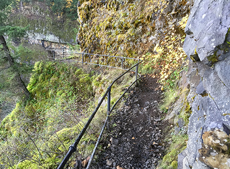 The catwalk section has reassuring railing atop the 300-foot cliffs