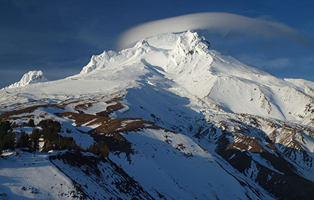 Lenticular cloud forming over The Mountain