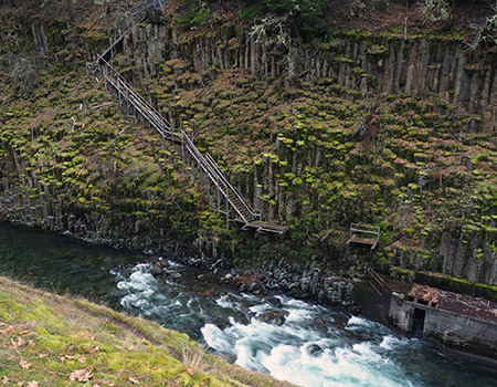 A rickety staircase descends the west wall of the canyon to the fish ladder