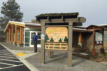 This carved sign welcomes visitors to the new facility