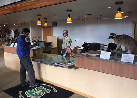 Rangers staff the new front desk at the visitors center