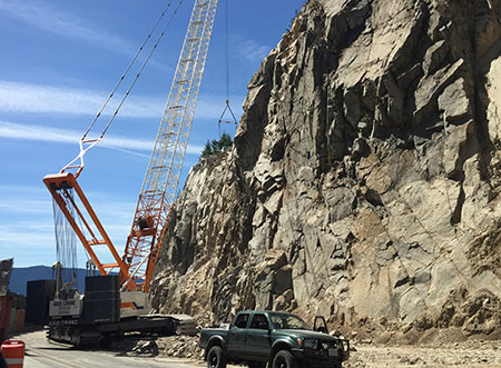 """The rock wall opposite the popular pullout at the """"map curve"""" is being massively cut back, supposedly to prevent loose rocks from landing on the highway… and to widen the road, of course"""