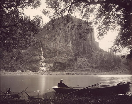 """Palisades, Columbia River"" This 1880s scene captured by Frank J. Haynes, official photographer for the Union Pacific Railroad. Crown Point (then called ""Thor's Heights"") and its lacy waterfall are the backdrop for what was known as Echo Bay in the early days of settlement."