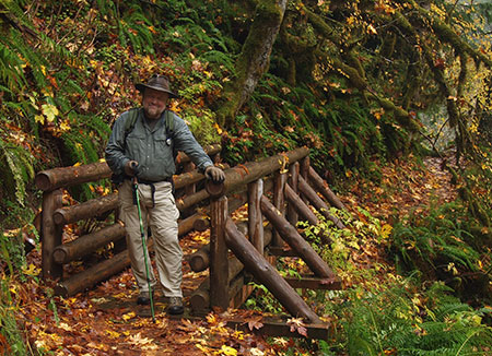 The author ankle-deep in maple leaves on the Butte Creek Trail