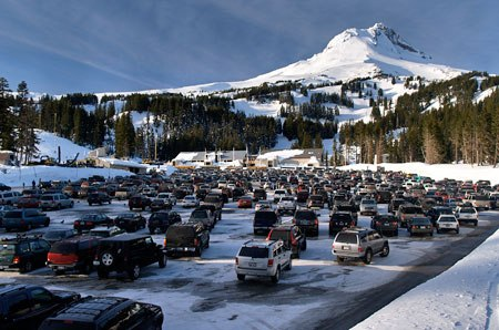 The price to park at Mount Hood's snow park lots is the same any day of the week, overloading parking areas and the Loop Highway
